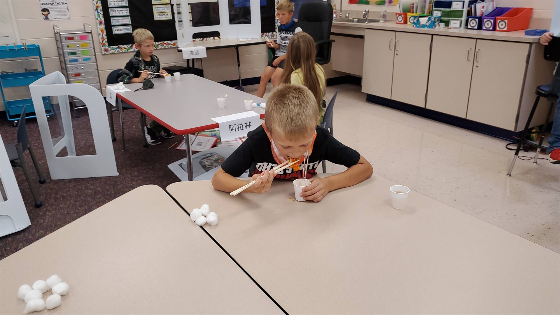 Student eating with Chopsticks
