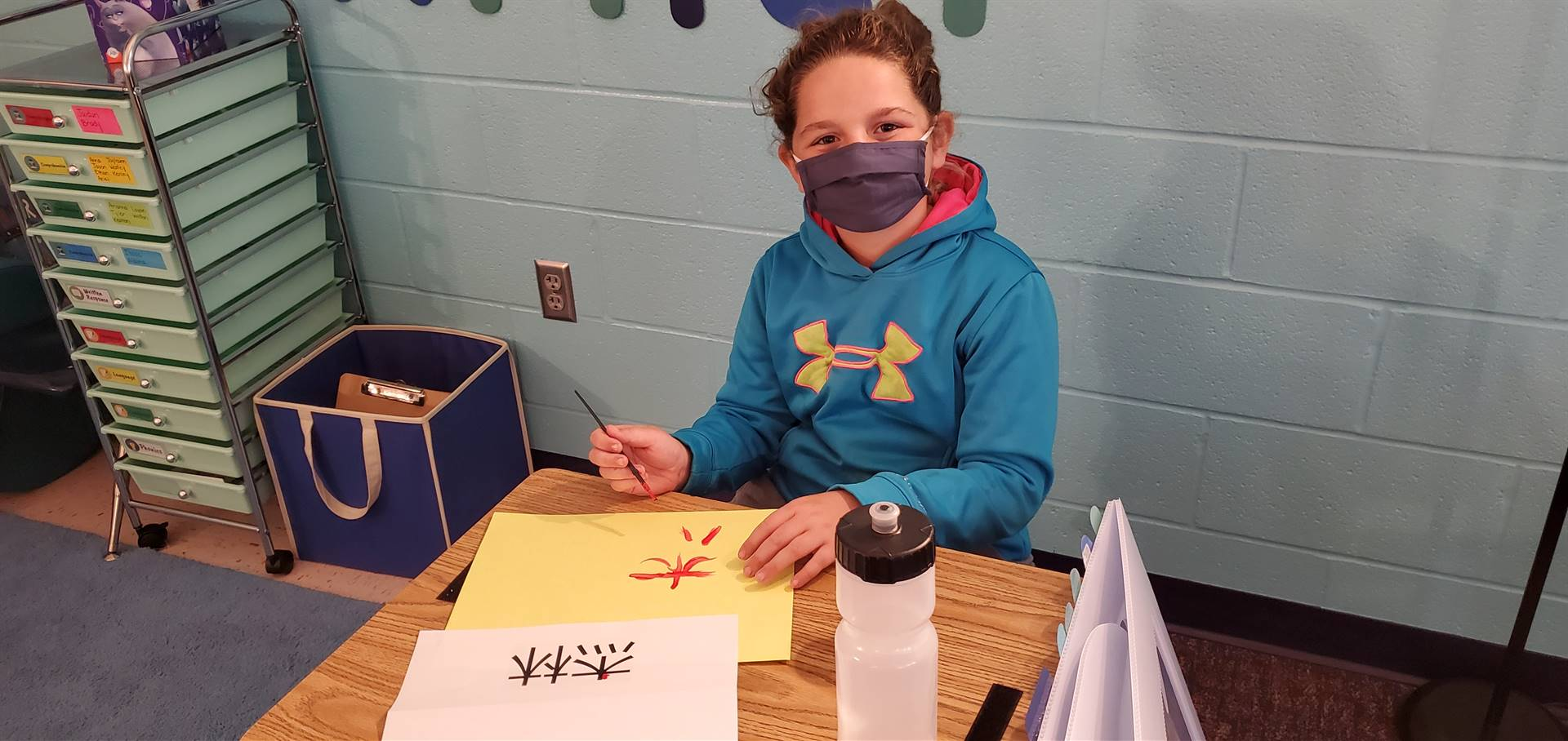 Student painting Chinese letters