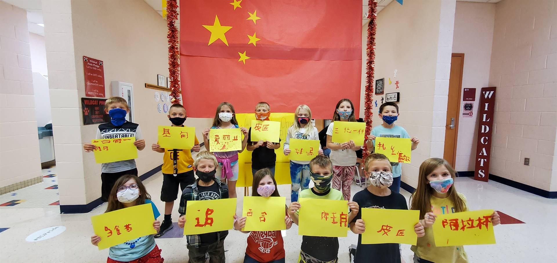 Class posing with Chinese Letters